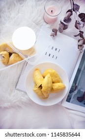 Durian Flat Lay on a Magazine with Fleece Background. Yellow durian flesh on a white table. Eating durian on the bed.