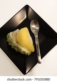 Durian ice cream and made look like real durian fruit, served on black plate