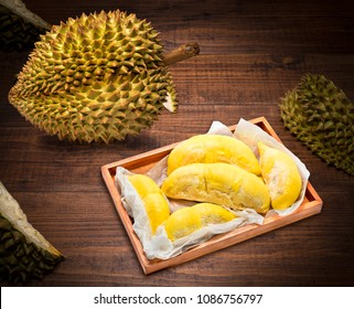 Durian the King of fruits, Durian fruit  on wooden background.durian fruit with delicious golden yellow soft flesh
