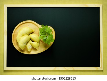 Durian the King of fruits, Durian fruit in wooden plate on blackboard .durian fruit with delicious golden yellow soft fresh.