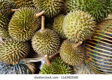 Durian is a large, oval, tropical fruit with a hard skin covered in sharp points, yellow or  orange flesh, and a very strong smell. It is also named King of Fruits.