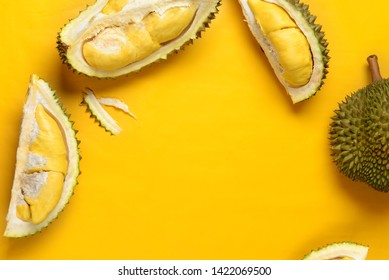 durian  on bright yellow background with copyspace