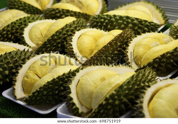 Durian on market . Stack of durain in the market . Close up Yellow fresh durain is king of fruit in Thailand. Pieces of durain fruit in white foam plate on display for sale.