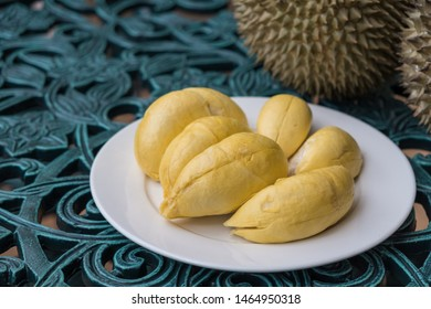 """Durian on white plate in background. Long stem or """"Kan yao"""" durian. The Most Expensive Durian. Durian the King of (tropical) fruits."""