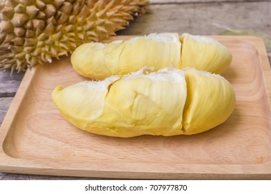 Durian on a wooden.Durian place on the wood support.