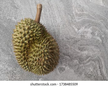 Durian with stone texture, grey background