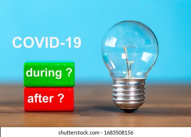 during , after are the words written on a red and a green toy block. On the background the word COVID-19 is written. Next to the tow blocks, an ancient light bulb stands freely and upright on a table
