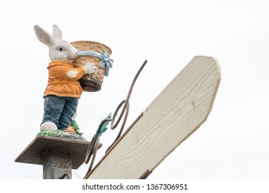 during Easter this rabbit stands with a flowerpot in its paws
