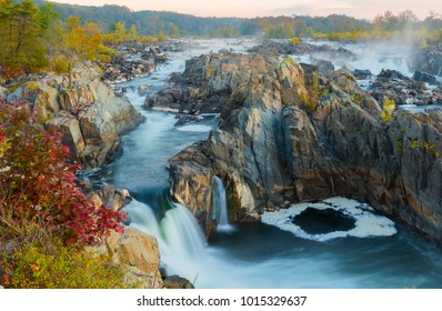 During the fall season Great Falls displays beautiful colors along the ripaians boundaries of the Potomac River near Washington DC. This view is from an overlook at Great Falls Park, VA