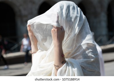 During the holiday of Rome's birthday, many of the maidens dress in traditional cloth clothing and carry offerings of war and religion.  Many dance through Rome with cymbals and scarves.