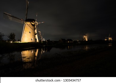 During night in the evening the world famous Kinderdijk in the Netherlands with the windmills illuminated