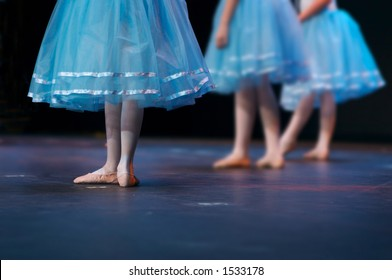 During a recital, one dancer stands out. Note: left dancer is in focus - enhanced to put right hand dancers more out of focus