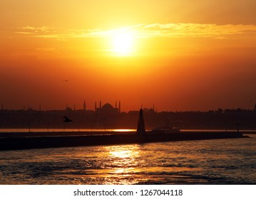 During the sunset breakwater, historical peninsula and Hagia Sofia, Istanbul, Turkey. This picture was taken from the Kadikoy District.