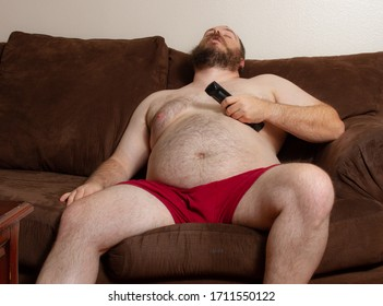 During the time of isolation man is sitting on the couch trying to relax