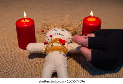 During a voodoo ceremony, a doll is stabbed in the heart with a needle
