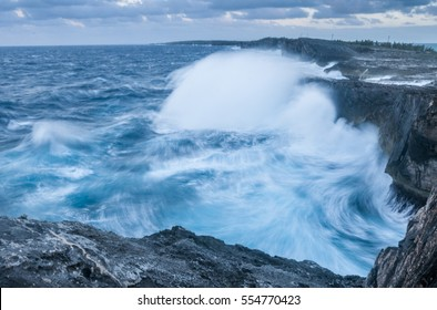 During a windy day waves crash into the cliffs of Eleuthera Island, Bahamas.