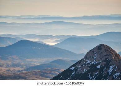 Durmitor landscape from Bobotov Kuk. Layers of mountains and clouds. Montenegro national park Durmitor. Sunrise landscape. Copyscape, place for text.