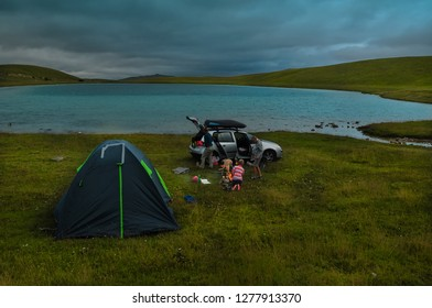 Durmitor National Park/ Montenegro AUG 2016 - The camping tents and Campfire near a lake in the summer evening in Durmitor National Park