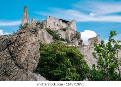 Durnstein, Austria, May 10, 2018: people admiring a scenic view over Wahau valley from the ruins of the castle.
