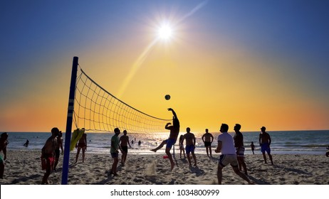 Durres, Albania - circa Aug, 2017: Playing beach volleyball at dusk