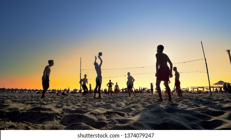 Durres, Albania - circa Aug, 2017: Beach volleyball at sunset is summer vacation active recreation,