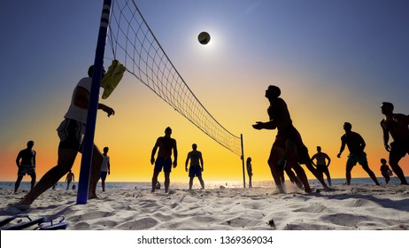 Durres, Albania - circa Aug, 2018: silhouette of volleyball players on the beach at sunset, cinematic steadicam shot