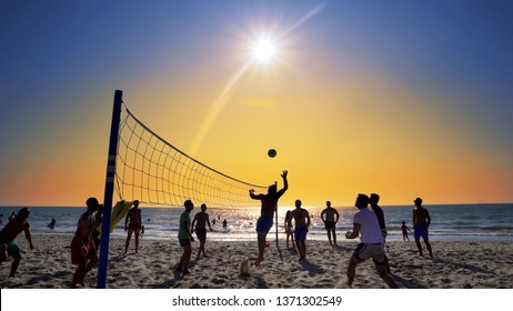 Durres, Albania - circa Aug, 2018: Silhouettes of young men playing volleyball on Varkala beach at sunset, Durres, Albania, SLOW MOTION