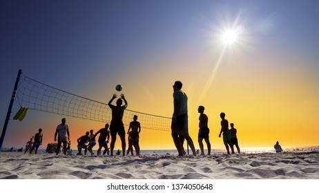 Durres, Albania - circa Aug, 2018: Unrecognizable Silhouette People Play Beach Volleyball at sunset
