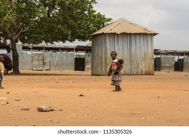 Durumi/Abuja/Nigeria/14.Apr.2018: A little girl taking care of a baby and living in the wooden makeshift place of Internally Displaced Persons in Abuja, the Federal Capital of Nigeria.