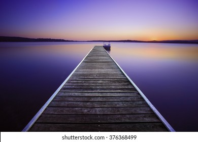 Dusk colors at Warners Bay jetty, Lake Macquarie, NSW, Australia. Was hoping for some clouds but the lack of haze and no clouds had its own showcase to offer. The stillness calms you down.