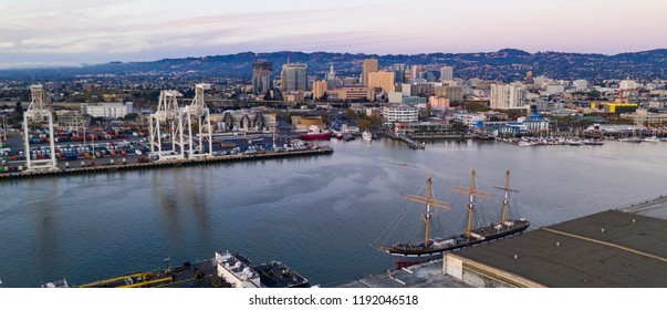 Dusk comes to Oakland California washing the harbor to the mountains in golden light