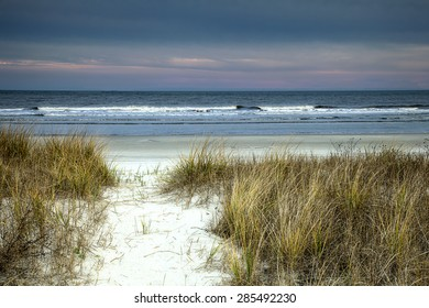 """""""Dusk in the Dunes' As the sun starts its final descent to sunset to my right, the eastern sky over the Atlantic reflects beautiful colors of dusk on Hilton Head Island, SC."""