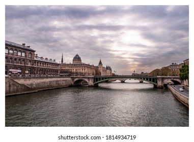 dusk falls on the seine river