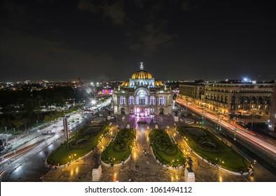 Dusk falls over the Palacio de Bellas Artes in Mexico City. Aerial view of Mexico city
