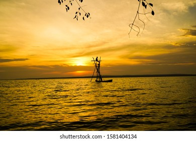 Dusk And Fishermen who are in the ocean