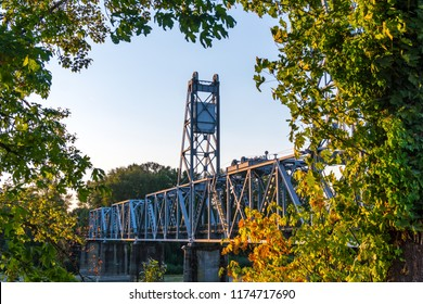Dusk Foliage at Union Street Foot Bridge in Salem, Oregon - It is a popular pedestrian and bicycle bridge converted from an old railroad track, crossing the Willamette River near downtown Salem.