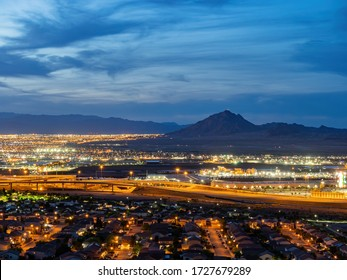 Dusk high angle view of the Frenchman Mountain and cityscape from Henderson View Pass at Nevada