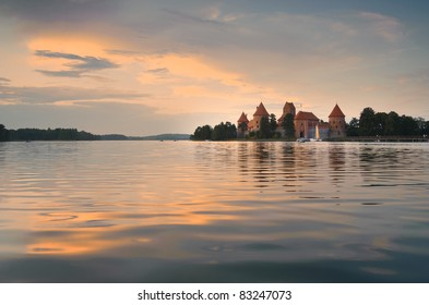 Dusk at the island castle of Trakai, one of the most popular tourist destinations in Lithuania. The castle was the medieval capital of Lithuania and houses a museum and a cultural center.