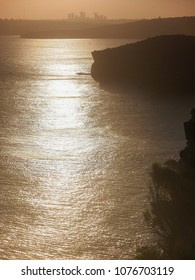 Dusk light falls over the ocean and cliffs on Sydney Harbour near Manly, New South Wales, Australia