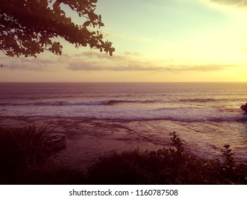Dusk Light Of The Ocean In Tanah Lot Temple Area, Tabanan, Bali, Indonesia