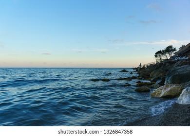 Dusk on the beautiful beach of Zelenyy Mys in Alupka. Crimea