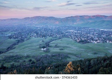 Dusk over Clayton and Mitchell Canyon from Mount Diablo State Park. Contra Costa County, California, USA.