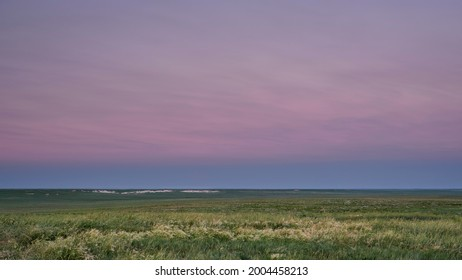 dusk over green windy prairie - Pawnee National Grassland in Colorado, early summer scenery