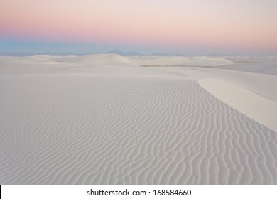 Dusk over gypsum sand dune shapes in White Sands National Monument, New Mexico