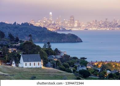 Dusk over St Hillary's Church, Angle Island, Alcatraz Prison, San Francisco Bay and San Francisco Skyline. Tiburon, Marin County, California, USA.