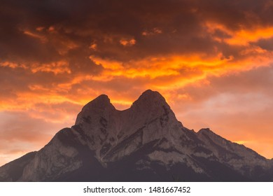 Dusk in the Pedraforca muntain with orange clouds, silhouette.