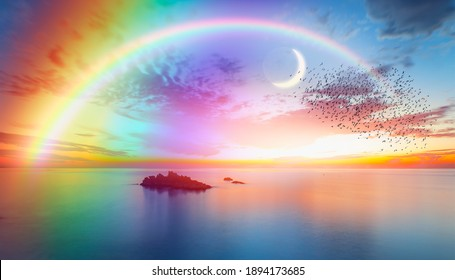 Dusk rainbow concept - Beautiful landscape with multi colored calm sea with double sided rainbow at dusk