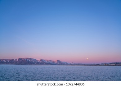 A dusk scene in reykjavik, Iceland. There are magical and powerful pastel purple sky.