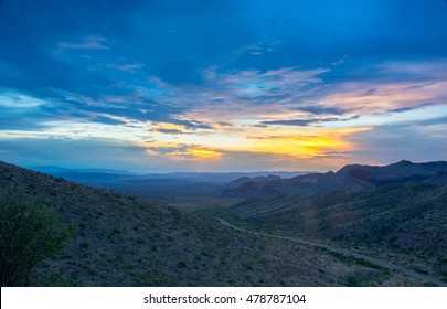 Dusk settles in after a colorful sunset in west Texas at big bend national park over the Ross Maxwell Scenic Drive road.