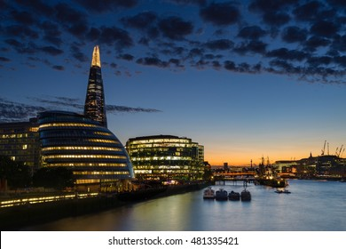 Dusk settles over London after sunset along the River Thames and downtown.